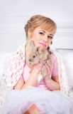 Young woman with a rabbit in hands Stock Photo