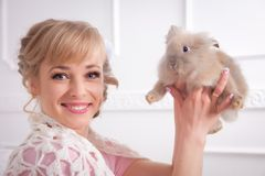 Young woman with a rabbit in hands Stock Image