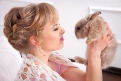 Young woman with a rabbit in hands Royalty Free Stock Photography