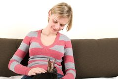 Young woman with a rabbit on her laps Royalty Free Stock Photography