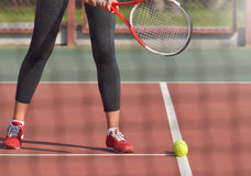 Young woman with racket ready to serve a tennis ball Stock Photos
