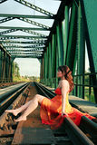Young woman on rail. Young woman sits on rail stock images