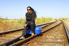 Young woman on a railroad track Royalty Free Stock Images