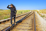 Young woman on a railroad track Stock Image