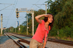Young woman on railroad waiting for the train Royalty Free Stock Images