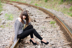 Young woman on the rails stock photos
