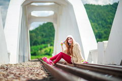 Young woman on the rails Stock Photo