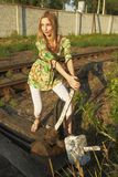 Young woman on railway Royalty Free Stock Photo