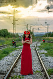 Young woman on the railway Royalty Free Stock Images