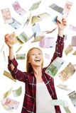 Young woman in rain of Euro money bills Stock Photo