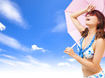 Young woman raise hand to cover sunlight with a umbrella Stock Photography