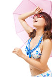 Young woman raise hand to cover sunlight with a umbrella. Over white background Royalty Free Stock Photos