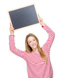 Young Woman raise up chalkboard Royalty Free Stock Images
