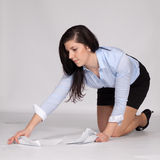 Young woman raised fallen documents Royalty Free Stock Photography