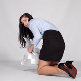 Young woman raised fallen documents Royalty Free Stock Images