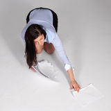 Young woman raised fallen documents Stock Photos