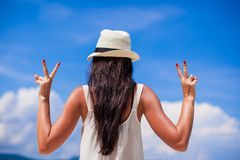 Young woman with raised hands at perfect beach Stock Photography