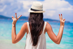 Young woman with raised hands at perfect beach on Royalty Free Stock Image