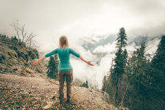 Young Woman raised hands relaxing outdoor Stock Photography