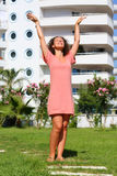 Young woman raised her hands enjoying the sun Royalty Free Stock Photography