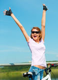 Young woman raised her hands up in joy Stock Image