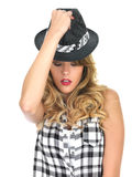 Young Woman Raising a Black Tilbury Hat Royalty Free Stock Photo