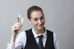 Young woman raising a glass of white wine Stock Images