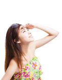 Young woman raising hand to cover sunlight Royalty Free Stock Image