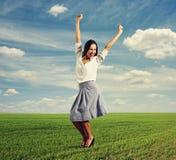 Young woman raising hands up Royalty Free Stock Photos