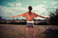 Young woman raising her arms and admiring the view Royalty Free Stock Photography