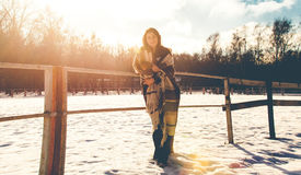 Young woman on ranch at winter day Royalty Free Stock Photo