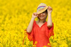 Young woman on rape field Royalty Free Stock Photos