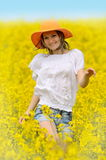 Young woman on rape field in bloom Royalty Free Stock Photography