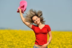 Young woman on rape field in bloom Royalty Free Stock Image