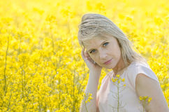 Young woman in the rape field Royalty Free Stock Images
