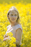 Young woman in the rape field Stock Photos