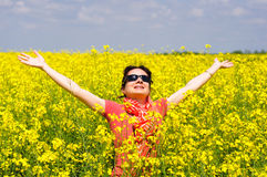 Young woman in a rape field Stock Images