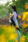 Young woman in the rape flower garden Royalty Free Stock Images