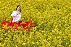 Young woman in the rape flower garden Stock Photos