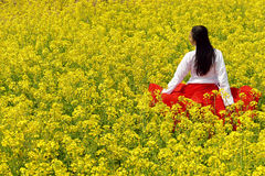 Young woman in the rape flower garden Stock Photo