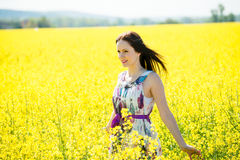 Young woman in rapeseed field Royalty Free Stock Images