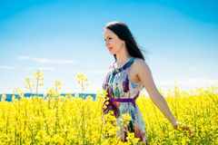 Young woman in rapeseed field Stock Images