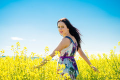 Young woman in rapeseed field Royalty Free Stock Photo