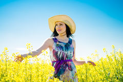 Young woman in rapeseed field Royalty Free Stock Photography