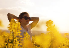 Young woman in the rapeseed field Royalty Free Stock Image