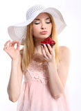 Young woman with a raspberry muffin Royalty Free Stock Photos