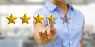 Young woman rating stars Stock Photography