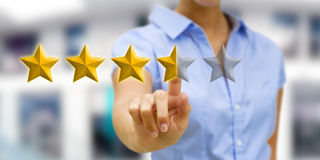 Young woman rating stars Stock Image