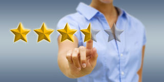 Young woman rating stars Royalty Free Stock Photo