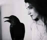 Young woman with raven Stock Photo